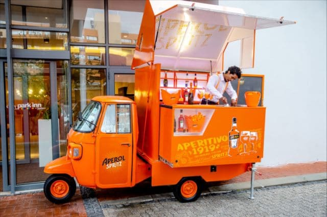 WHY YOUR NEXT EVENT SHOULD INCLUDE APEROL SPRITZ tuk tuk parked